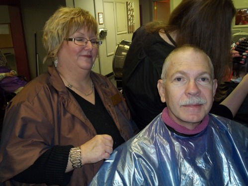 At the Murphy Beauty College, Deb checks Father's preparations for Easter.